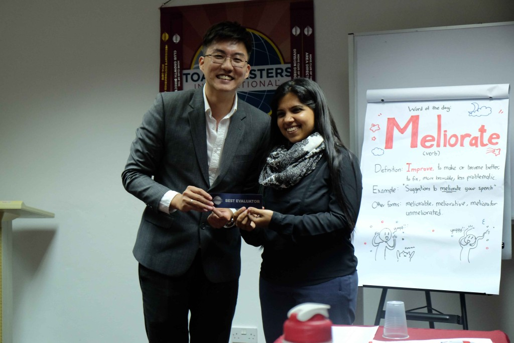 TM Pooja receiving her Best Evaluator RIbbon from our president Chris Woo, CC