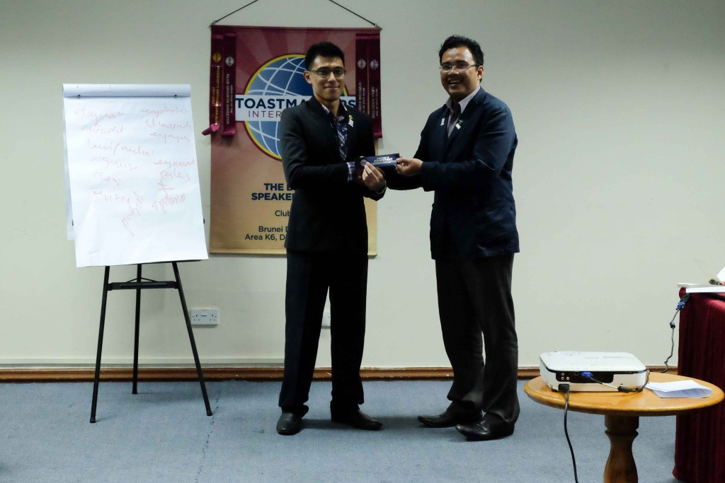 TM Macalister Mak receiving his Halfway to Competent Communicator ribbon