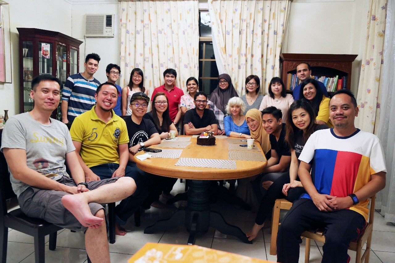 Jidun (second left, in yellow) at a BSC dinner gathering